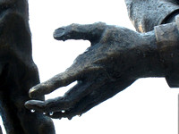 "Outstretched hand of Lincoln's friend, David Davis, the figure on Lincoln's right in ""Convergence of Purpose"" by sculptor Andrew Jumonville"