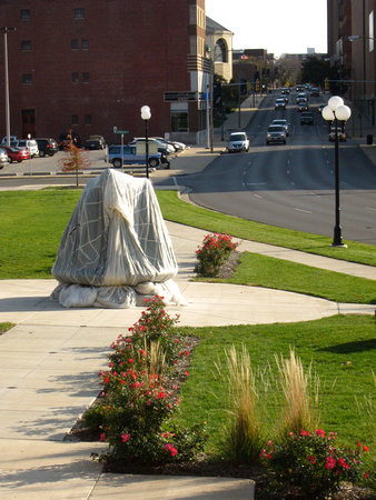 The sculpture was installed in early October 2010 in Lincoln Park next to the Bloomington Center for the Performing Arts. The figures and the base were draped in silk parachutes prior to the unveiling